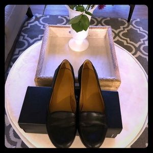Naturalized black leather flats